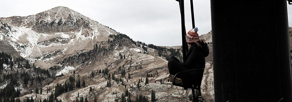 Girl Looking At Snowless Mountains